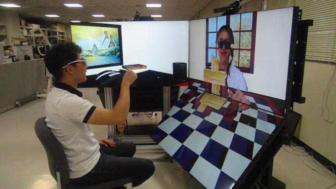 서로 떨어진 공간에 있는 두 사용자가 가상현실 기술을 이용해 함께 젠가 게임을 하고 있는 모습. 직적 가상공간에 있는 나무토막을 움직일 수 있다. - KIST 제공