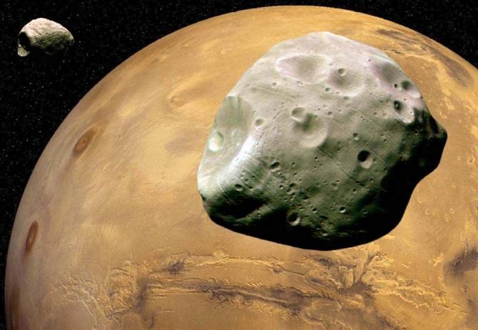 화성(황토색)의 두 위성 '포보스'(오른쪽)와 '데이모스'의 상상도. - 위키미디어 제공