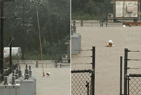 홍수 현장, 위험한 작업을 하는 남자