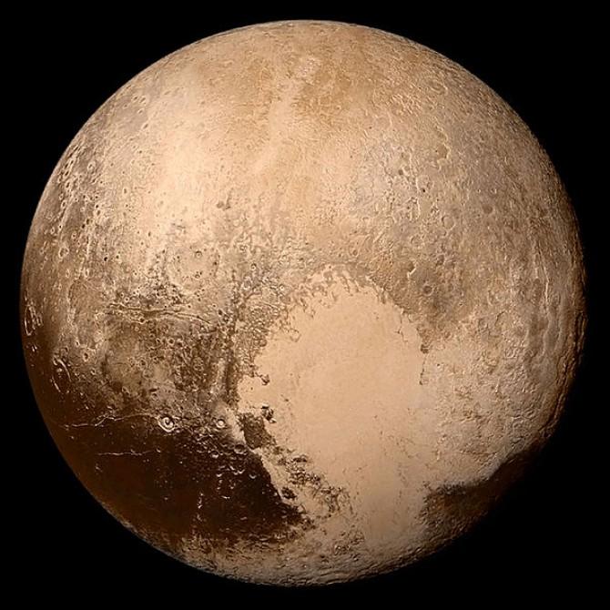 2015년 뉴 호라이즌스호가 명왕성 표면에 있는 하트 모양 지형을 사진으로 찍었다. - 미국항공우주국 제공