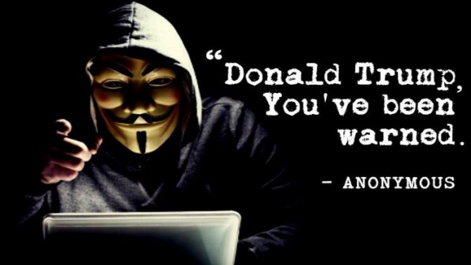 가이 포크스의 가면을 쓰고 도날드 트럼프 대통령 당선자에게 경고를 보내는 어나니머스 - 어나니머스 제공