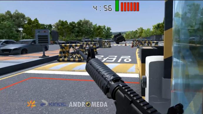 KINAC의 VR교육 프로그램 VR-NET 착용시 나타나는 화면. 기자가 총을 든 채 정문으로 돌격해오는 차량을 바라보고 있다. - 안드로메다 스튜디오 제공