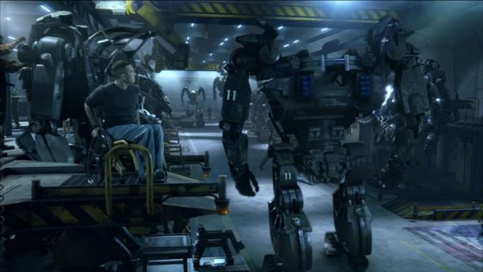영화 아바타의 한 장면. 주인공이 AMP 슈트를 정비 중인 격납고를 돌아보고 있다.