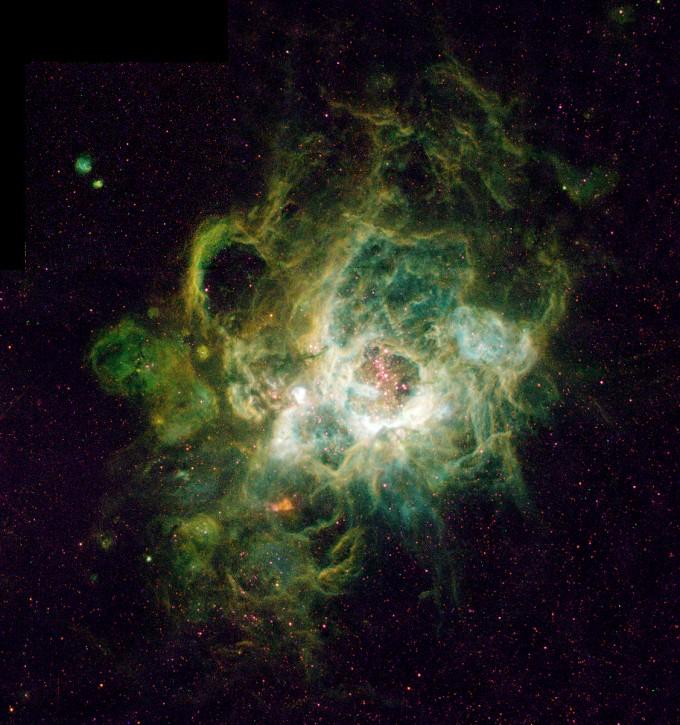 빛의 속도로 270만 년 가야 하는 거리에 위치한 성운 NGC604.밝은 부분이 이온화된 수소가 있는 부분이다. 여기에서 별이 탄생하는 과정을 보여준다. 사진제공 NASA