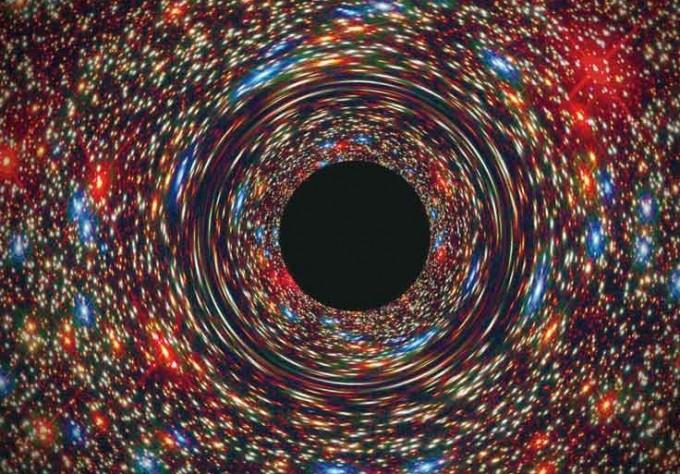 블랙홀의 상상도. 천체물리학자들은 전파망원경을 동원해 블랙홀의 그림자를 촬영하기 시작했다. 4월, 마침내 그 결과가 공개된다. NASA, ESA, and D. Coe, J. Anderson, and R. van der Marel(STScI)