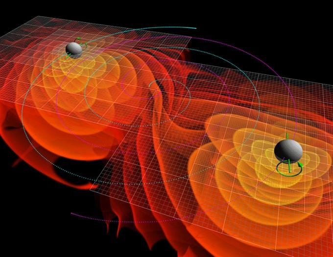 충돌하는 두 블랙홀이 주변에 중력파를 발생시키는 모습을 그렸다. 중력파는 그 동안 빛을 통해 관측하기 어려웠던 블랙홀 연구에 새 돌파구를 열었다. 사진제공 NASA