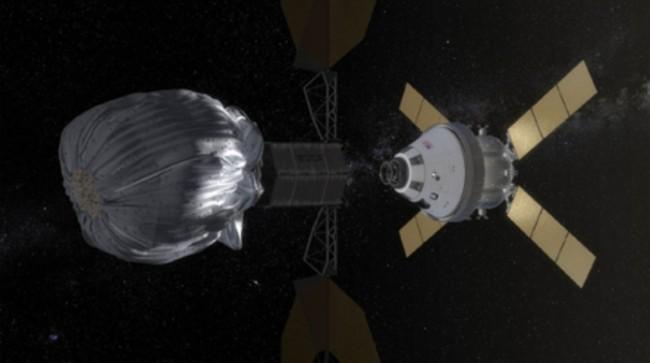 미국항공우주국(NASA)이 계획하고 있는 광물 채취 위성이 소행성을 향해 날아가는 모습의 상상도. 원통형의 그물망에 소행성 조각을 넣어 달 궤도까지 끌고 온다. NASA