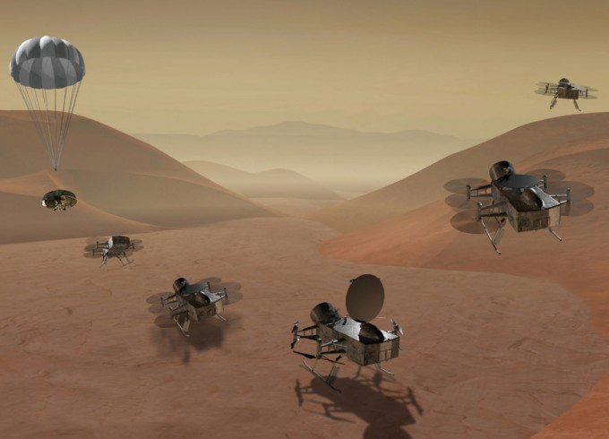 무인탐사선 ′드래건플라이(Dragonfly)′가 토성의 위성 타이탄의 지면에 접근하는 모습을 그린 상상도. 드래건플라이는 2034년 타이탄에 착륙해 생명체의 흔적이 있는지 조사할 예정이다. NASA 제공