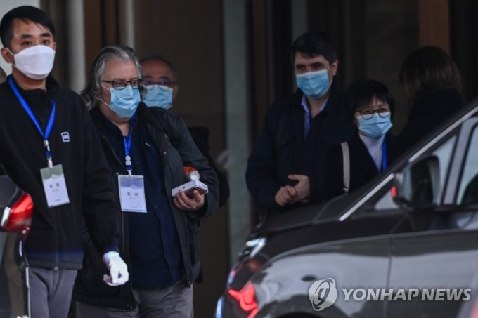 WHO 코로나19 국제조사단이 질병의 기원을 밝히기 위해 우한연구소·화난시장을 방문했다. 연합뉴스 제공